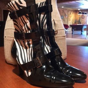 Black patent leather boot with zebra print